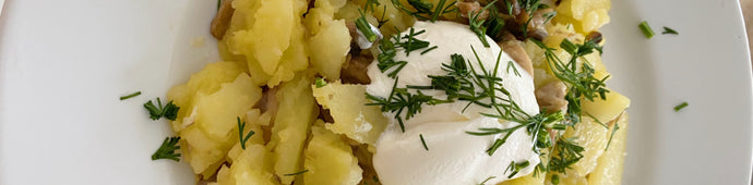 FRIED POTATOES AND MUSHROOMS IN PROVENCAL BUTTER WITH SOUR CREAM