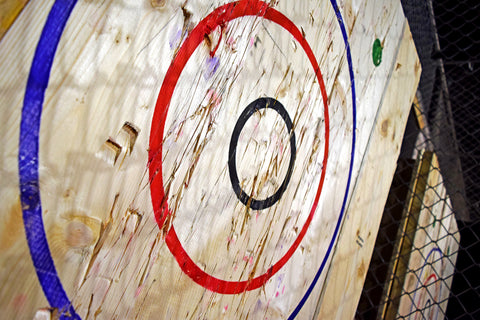 plywood sheet with painted target for ax throwing
