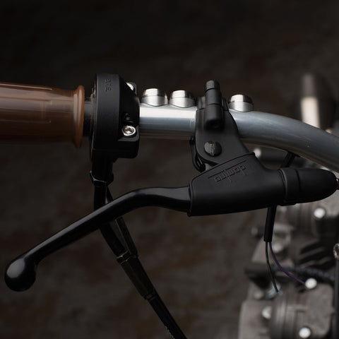 domino classic cable brake assembly mounted on handlebars