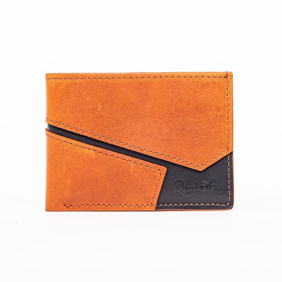 Front view of the tan and black leather Presidio Bi-Fold Wallet showcasing the asymmetrical seam details and a stamped Revival logo.