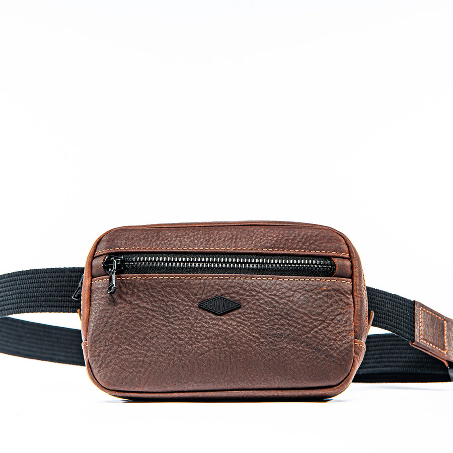 Front view of mahogany Kilo Bag showcasing the front zipper