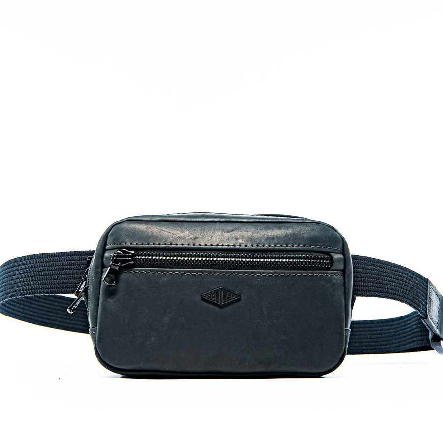Front view of the black Kilo Bag showcasing the front zipper pocket