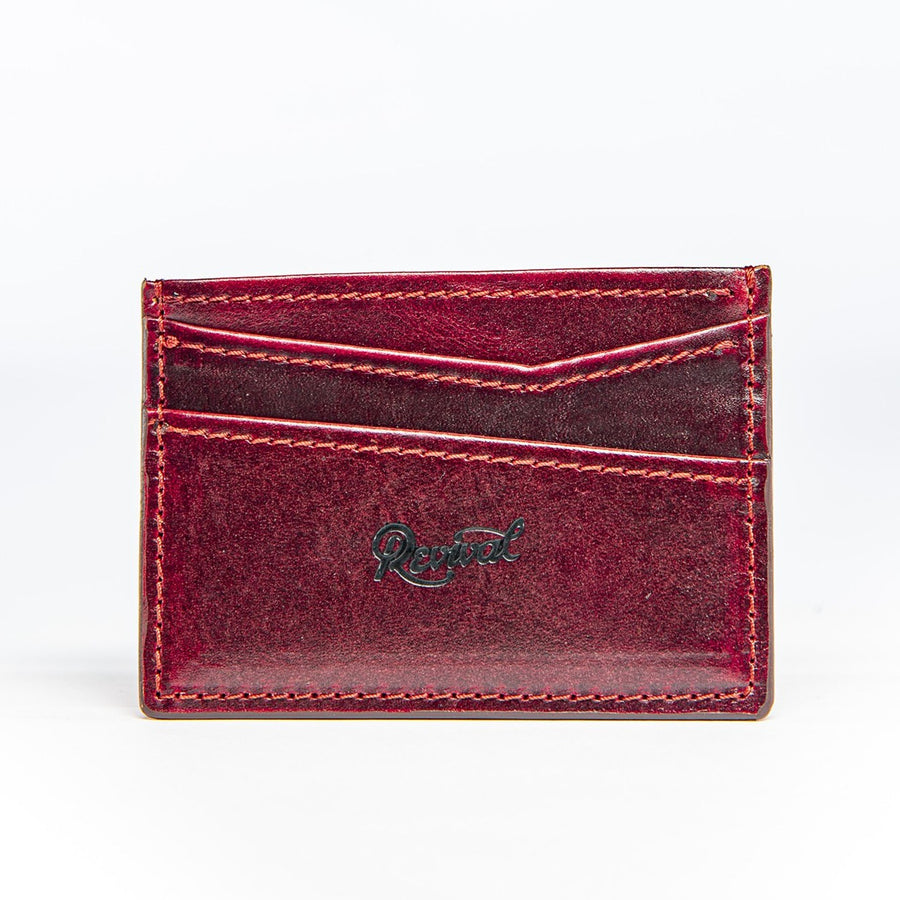 Front view of the oxblood leather Alimony Card Wallet featuring it's asymmetrical card slot.