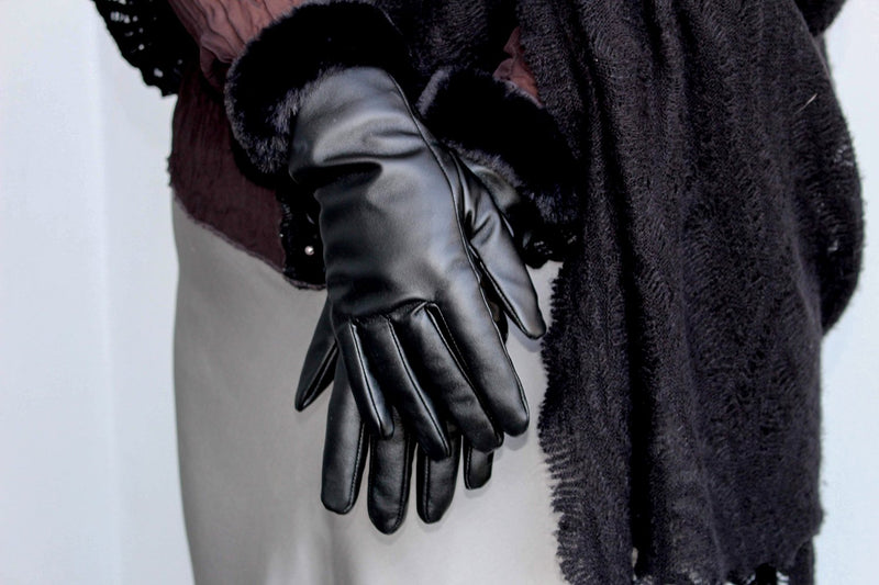 Black leather gloves with a fur wrist