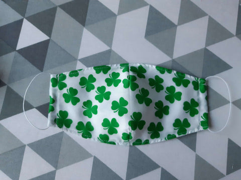 Homemade face mask with clover pattern