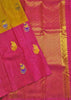 Folded view of Fasnic's yellow and pink kanjivaram silk borderless saree with doll design. Unstitched blouse attached