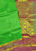 Folded view of Fasnic's Green Light wight silk saree with Floral design. Unstitched blouse attached