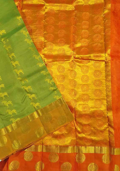 Folded view of Fasnic's green and orange light wight silk saree with Floral design. Unstitched blouse attached