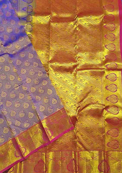 Folded view of Fasnic's Blue kanjivaram silk saree with floral design. Unstitched blouse attached