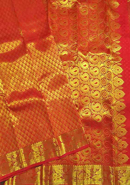 Folded view of Fasnic's Red kanjivaram silk saree with floral design. Unstitched blouse attached
