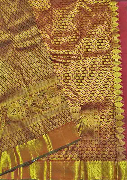 Folded view of Fasnic's Golden kanjivaram silk saree with floral design. Unstitched blouse attached