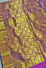 Full view of Fasnic's Golden kanjivaram silk saree with floral design. Unstitched blouse attached