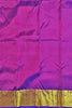 Blouse view of Fasnic's Golden kanjivaram silk saree with floral design. Unstitched blouse attached