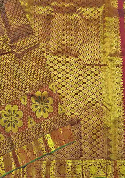 Folded view of Fasnic's Golden & Brown kanjivaram silk saree with floral design. Unstitched blouse attached