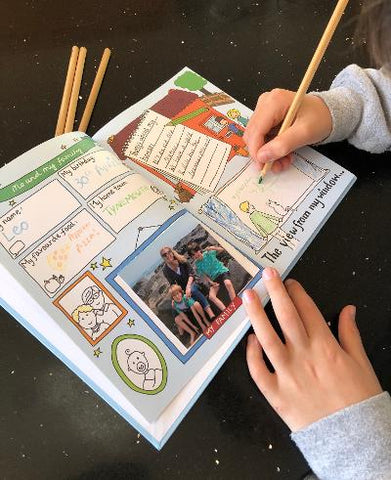 Image of child filling in their pages of the You and Me friendship book