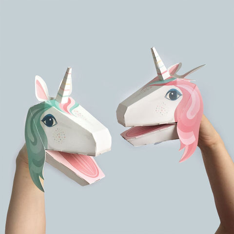 Image of the unicorn puppets made, one has blue/green hair and the other pink