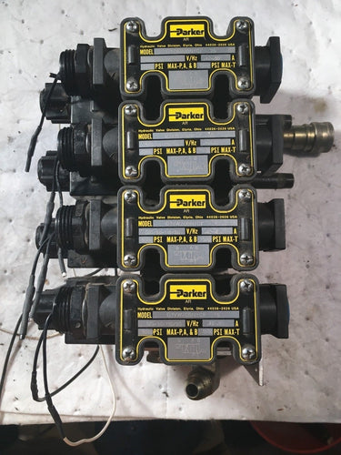 4 PARKER 5000 PSI D1VW20BNYCF SOLENOID VALVES on a manifold