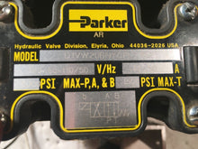 Load image into Gallery viewer, 4 PARKER 5000 PSI D1VW20BNYCF SOLENOID VALVES on a manifold