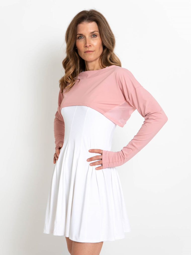 Woman wearing pink lightweight UPF 50+ (sun-protective) crop top with hand protection.