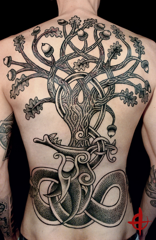 Yggdrasil back tattoo done by Colin Dale featuring a massive interwoven tree with a serpent biting its roots
