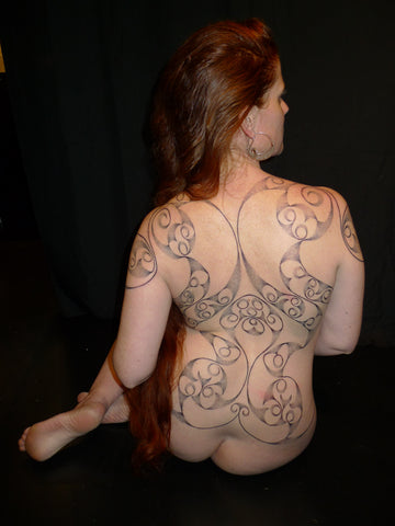 La Tene tattoo by Colin Dale covering back of woman.