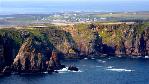 Tory Ssland image by Julianne Ford, showing water on the sea and green island cliffs