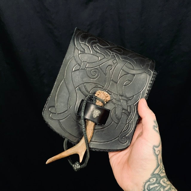 urnes style dragon design hand pressed into leather belt bag by sacred knot
