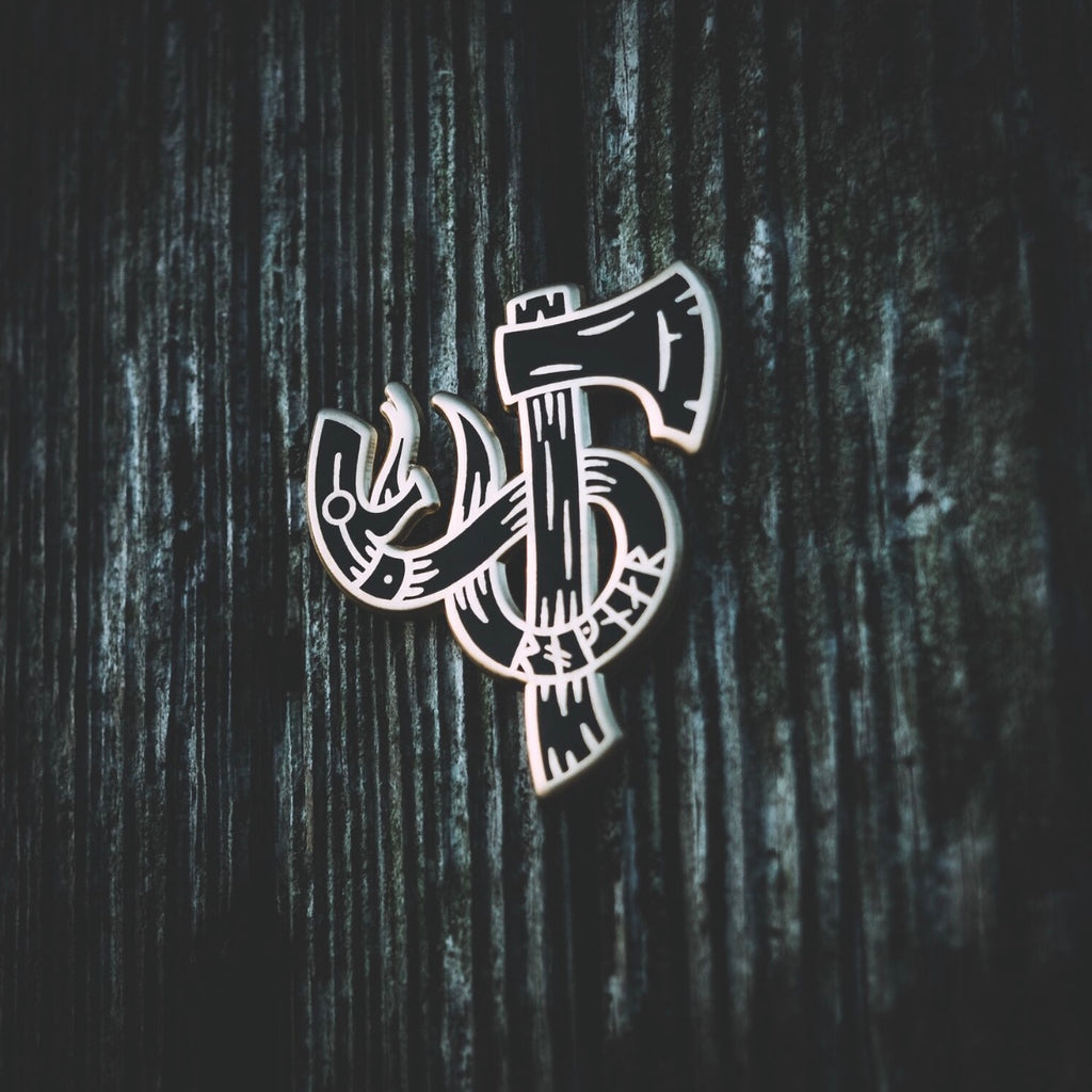 Ragnar axe and snake enamel pin designed by Badger King Tattoo for Northern Fire Designs