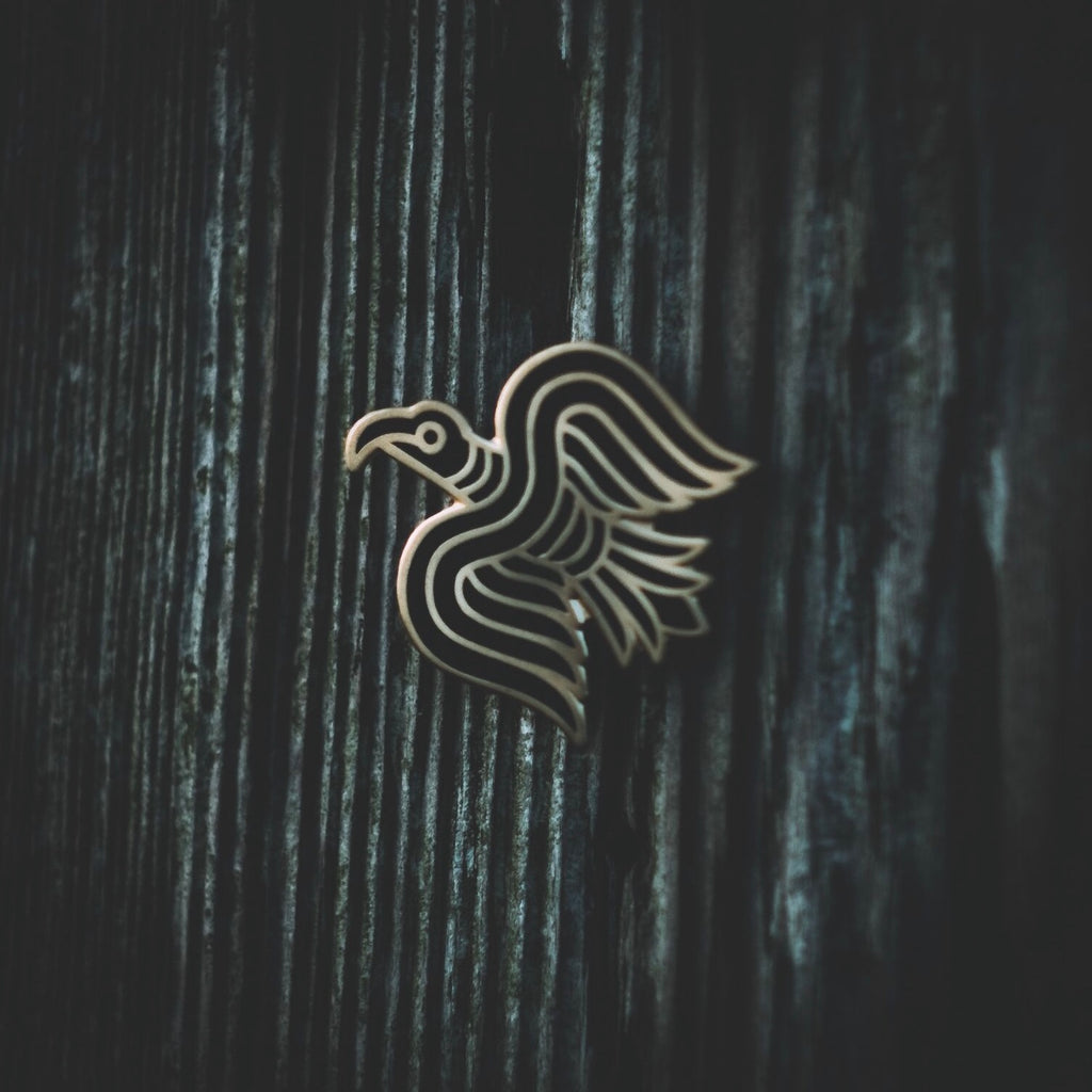 Raven Banner enamel pin created by Badger King Tattoo for Northern Fire Designs. Inspired by the Harald Hardrada banner in 1066 and Viking god Odin's ravens hugin and munin.