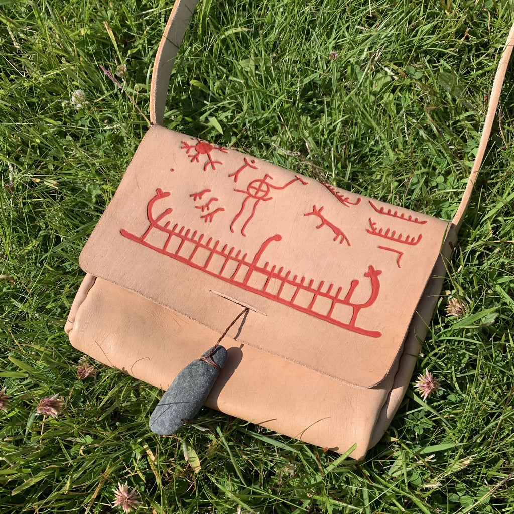 Scandinavian leather bag with bronze age cave art design by Sacred Knot Tattoo. Ethically sourced veg tan leather.