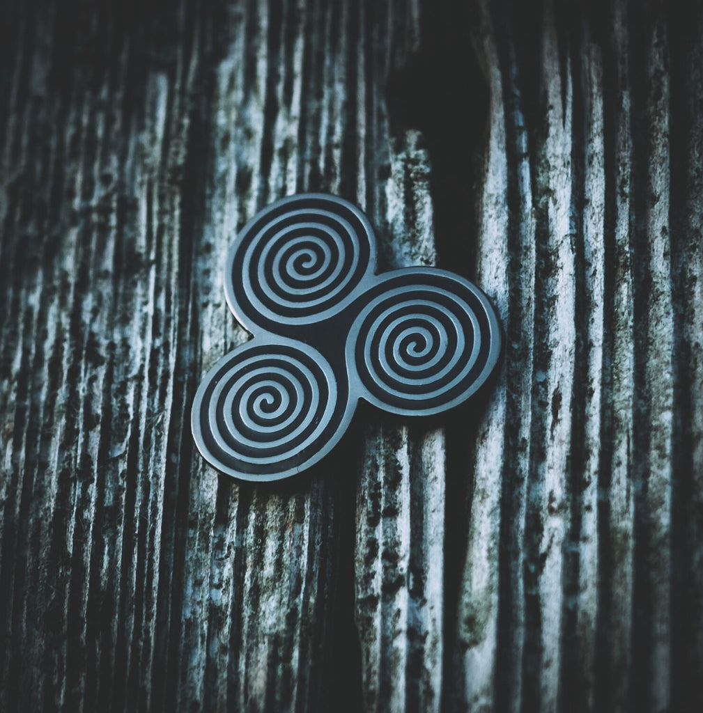 Celtic Triskel Enamel Pin designed by Sean Parry of Sacred Knot Tattoo for Northern Fire. Photography by Jamie Massie Photography