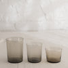 Clean lined glass tumbler in three sizes and available in multiple colors.