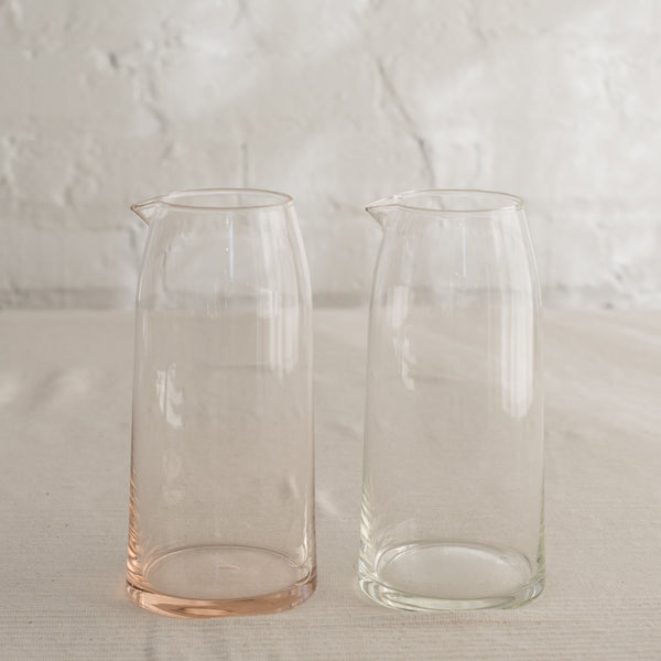 Mid-century modern shape glass pitcher in peach and clear.
