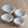 stoneware measuring cups - set of four nesting measuring cups - stoneware measuring cups - white measuring cups - be home - be home measuring cups