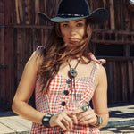 Women's western jewelry with cuffs, rings, and bolo