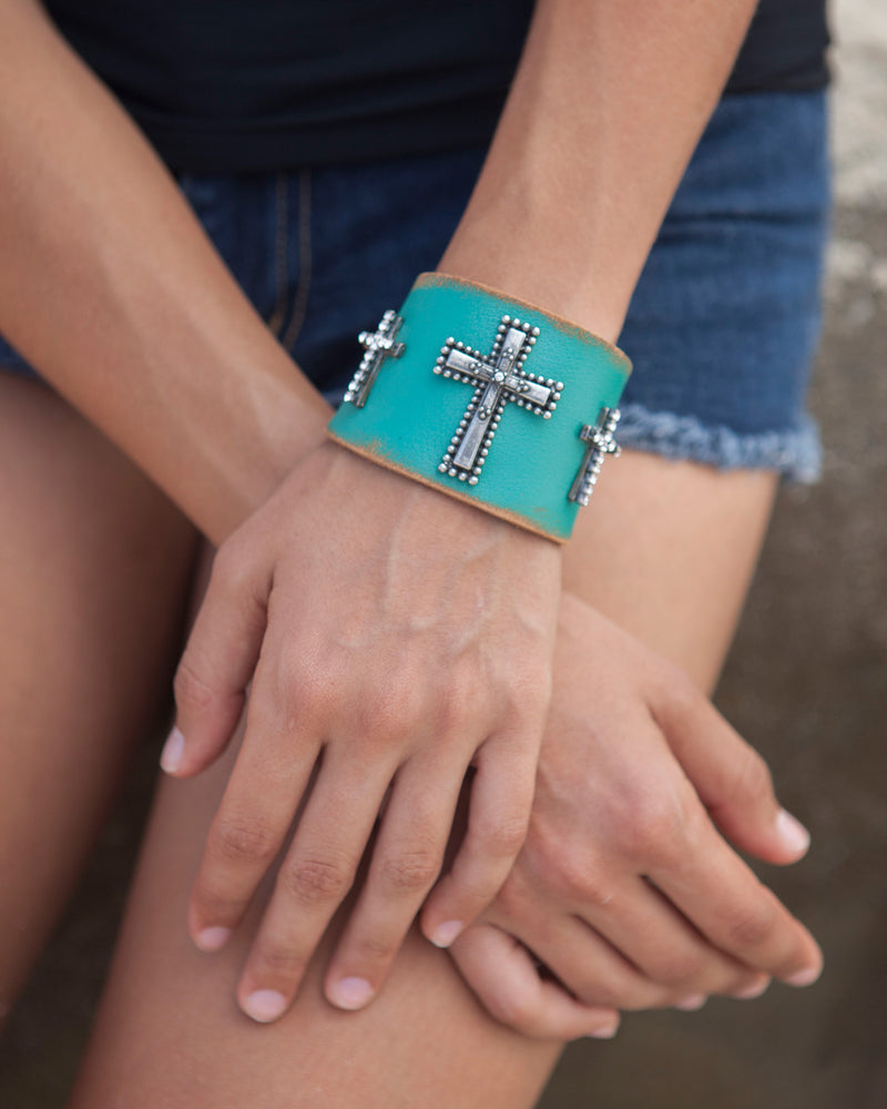Distressed Turquoise Leather Cuff with Antiqued Silver Crosses and Inlayed Crystals Flat View