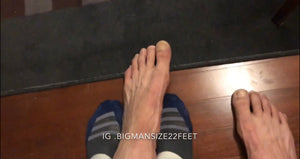 Jandro comparing feet in my hotel Room
