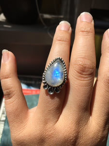 Moonstone pear ring with beaded border and loops - size 6