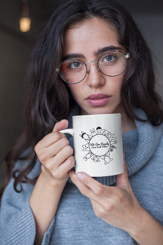 products/coffee-mug-mockup-featuring-a-woman-with-round-glasses-22435.jpg