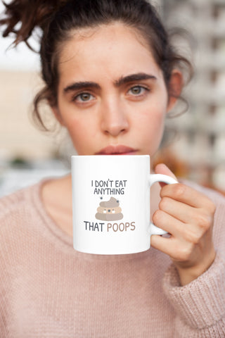 I Don't Eat Anything That Poops Mug for vegans out there! UltraVe provides premium vegan clothing that are cruelty-free, ethical and sustainable. 10% of our profits are donated to animal welfare charities. We have vegan hoodies, vegan tshirts, vegan sweatshirts. Go Veganism!!