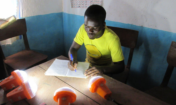 Working by the light of solar lamps at St Martin's school in Nambuma, Malawi.