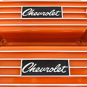 ansen custom engraving, small block chevy logo valve covers, orange, close up view