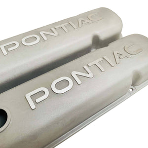 ansen valve covers, pontiac, raised letter logo, as cast finish, close up view