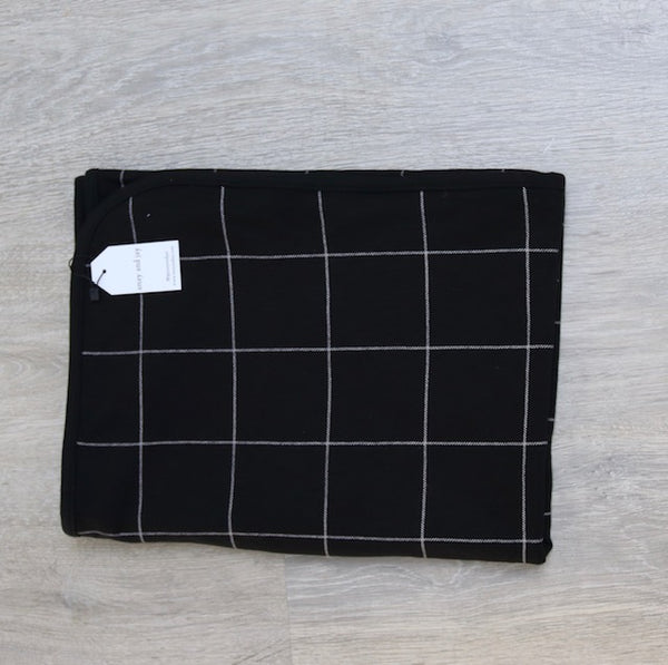Reversible jersey black check and safari print blanket