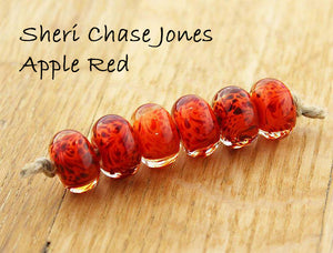 Apple Red over orange by Sheri Chase Jones