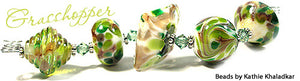 Grasshopper frit blend by Glass Diversions - beads by Kathie Khaladkar
