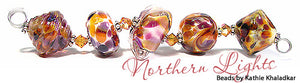 Northern Lights frit blend by Glass Diversions - beads by Kathie Khaladkar