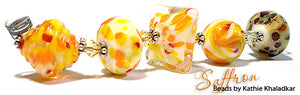 Saffron frit blend by Glass Diversions - beads by Kathie Khaladkar