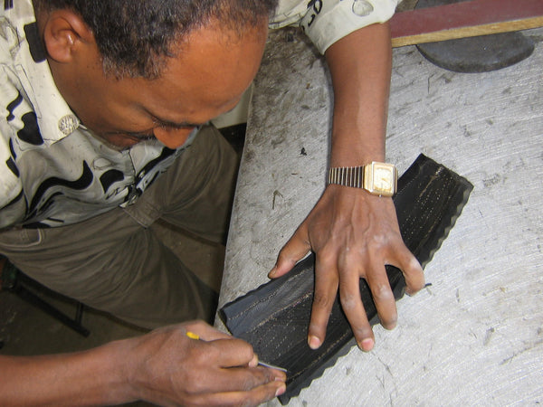 recycled tire sole being made