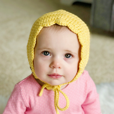 Super cute yellow baby girl crochet bonnet
